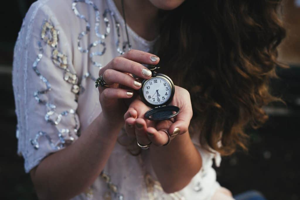 woman holding a pocket watch